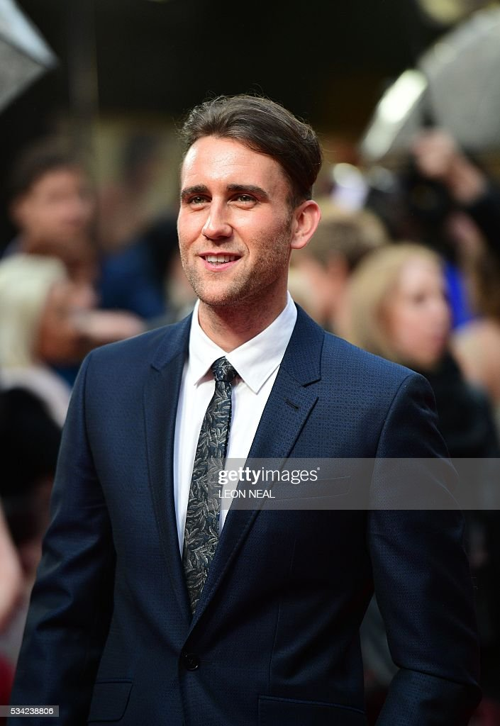 British actor Matthew Lewis poses for pictures as he arrives for the European Premiere of the film 'Me Before You' in central London, on May 25, 2016. / AFP / LEON