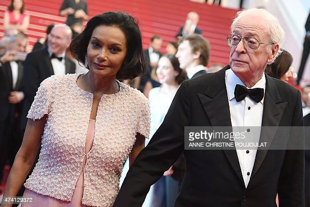 British actor Michael Caine and his wife Shakira leave the Festival palace after the screening of the film 'Youth' at the 68th Cannes Film Festival...