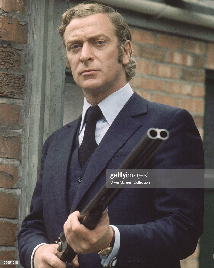 British actor <a gi-track='captionPersonalityLinkClicked' href=/galleries/search?phrase=Michael+Caine&family=editorial&specificpeople=159746 ng-click='$event.stopPropagation()'>Michael Caine</a> toting a shotgun on the set of 'Get Carter', circa 1971.