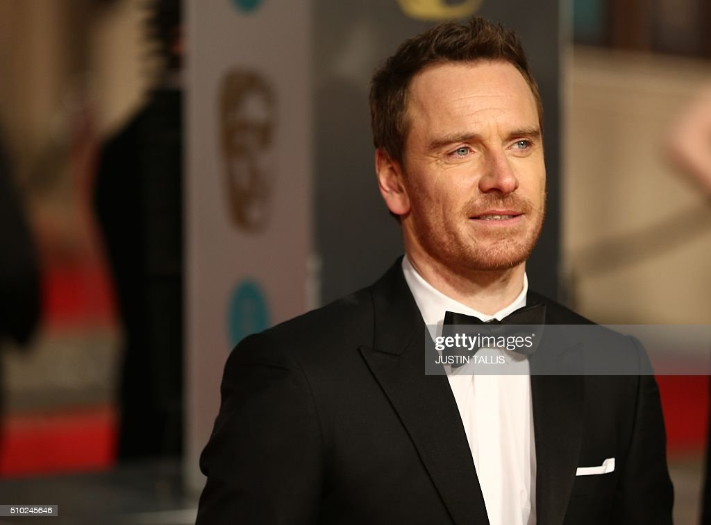 British actor Michael Fassbender poses on arrival for the BAFTA British Academy Film Awards at the Royal Opera House in London on February 14, 2016. TALLIS