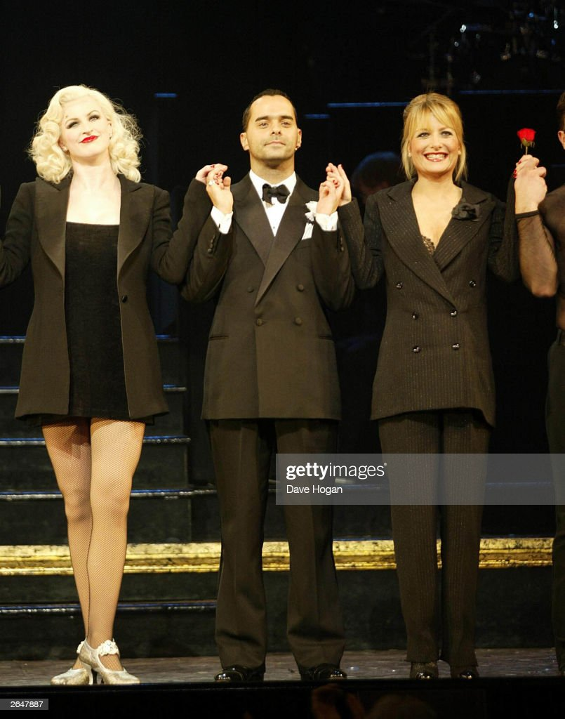 British actor Michael Greco and actress Gaby Roslin perform on stage alongside the cast at the 5th birthday of Chicago the musical at the Adelphi Theatre on November19, 2002 in London.