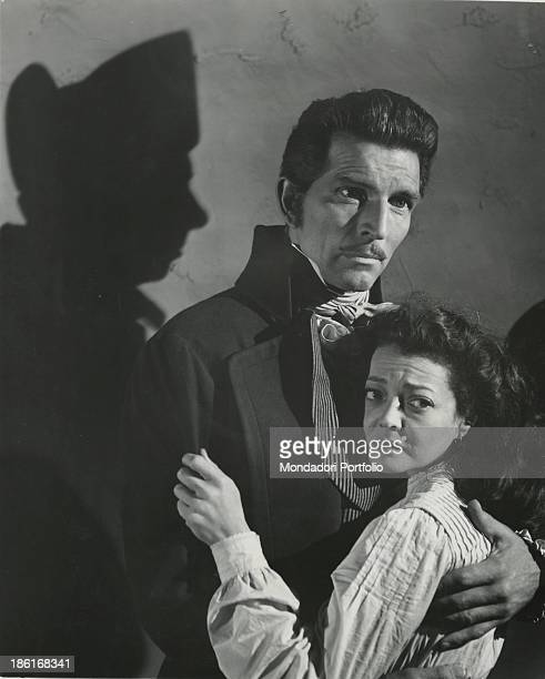 British actor Michael Rennie hugging American actress Debra Paget in the film Les Misérables 1952