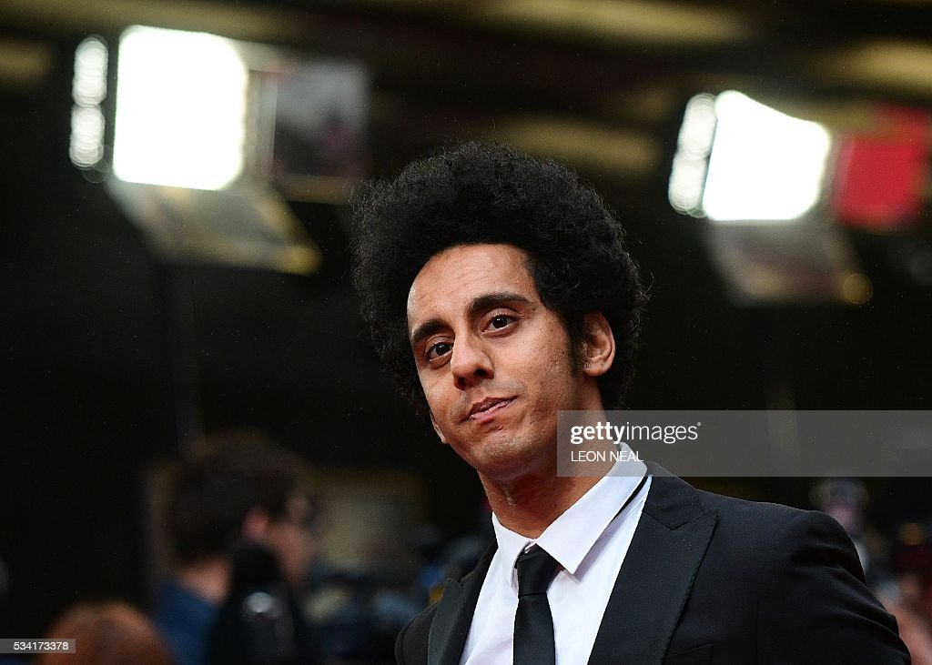 British actor Muzz Khan poses for pictures as he arrives for the European Premiere of the film 'Me Before You' in central London, on May 25, 2016. / AFP / LEON