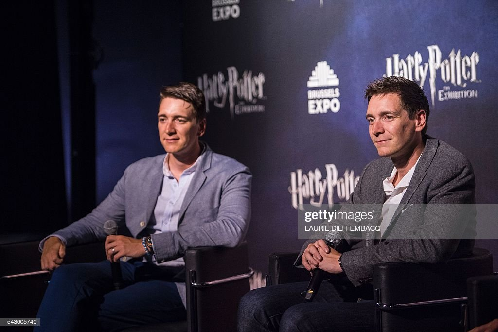 British Actor Oliver Phelps (L) and British Actor James Phelps (R) give a press conference at Harry Potter - The Exhibition in Brussels on June 29, 2016. / AFP / BELGA / LAURIE DIEFFEMBACQ / Belgium OUT
