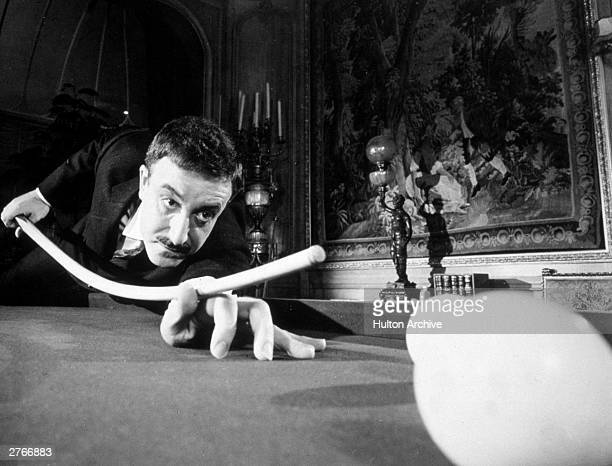 British actor Peter Sellers as Inspector Clouseau tries to play pool with a bent cue in a still from director Blake Edwards's film 'A Shot in the...