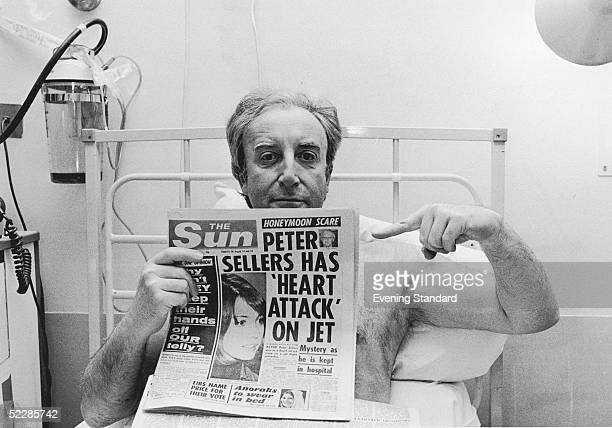 British actor Peter Sellers points to a headline in 'The Sun' which speculates about his current period of hospitalisation 21st March 1977 The...