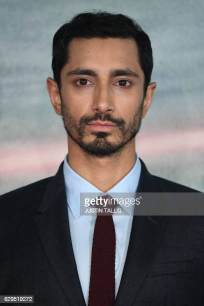 British actor Riz Ahmed poses upon arrival at the UK launch event of Lucasfilm's 'Rogue One A Star Wars Story' at the Tate Modern in central London...