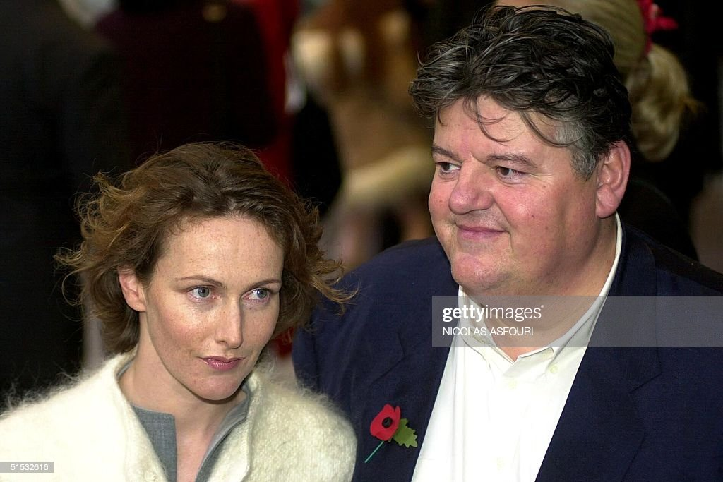 British actor Robbie Coltrane and his girlfriend arrive for the world film premiere of the new Harry Potter and the Chamber of Secrets in central London 03 November 2002. Robbie Coltrane plays Rubeus Hagrid in the second Harry Potter film The Chamber of secrets, the sequel to The Philosopher Stone. AFP PHOTO Nicolas ASFOURI