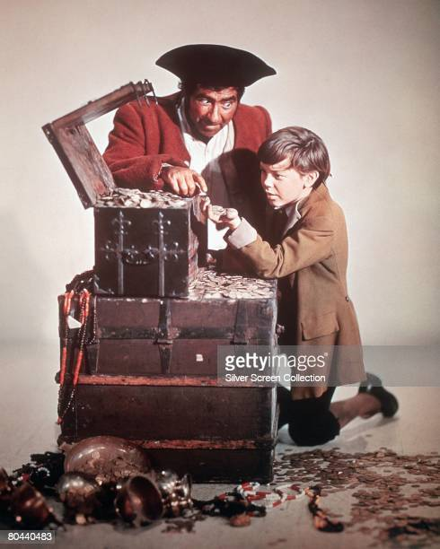 British actor Robert Newton as Long John Silver and Bobby Driscoll as Jim Hawkins in the film 'Treasure Island' 1950