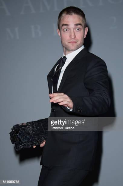 British actor Robert Pattinson holds the achievement tribute award he received during the 43rd Deauville American Film Festival on September 2 2017...