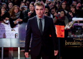 British actor Robert Pattinson poses on the red carpet upon arrival for the premier of 'The Twilight Saga Breaking Dawn Part 2' film premier in...