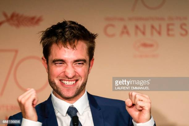 TOPSHOT British actor Robert Pattinson talks on May 25 2017 during a press conference for the film 'Good Time' at the 70th edition of the Cannes Film...
