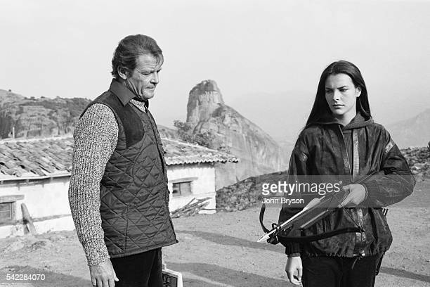 British actor Roger Moore and French actress Carole Bouquet on the set of the James Bond opus For Your Eyes Only directed by John Glen