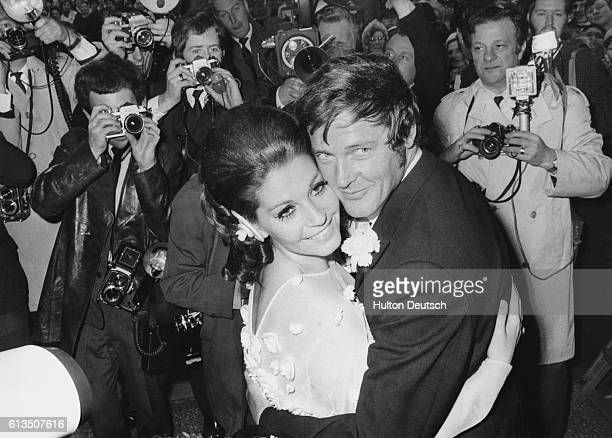 British actor Roger Moore and his wife Italian actress Luisa Mattioli leaving Caxton Hall after their wedding ceremony