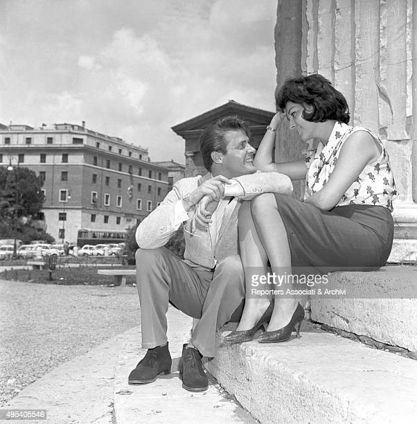 British actor Roger Moore and Italian actress Luisa Mattioli having a break from the shooting of the film Romulus and the Sabines Rome 1961
