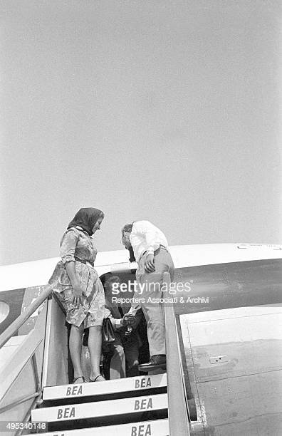 British actor Roger Moore arriving at Fiumicino airport with his third wife and actress Luisa Mattioli Rome 1962