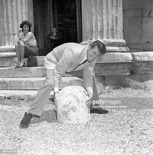British actor Roger Moore joking watched by amused Italian actress Luisa Mattioli among the ruins of Roman Forum The actors have a break on the set...