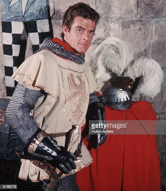 British actor Roger Moore later famed for his portrayals of The Saint and James Bond stars as Sir Wilfred of Ivanhoe in a television remake of Walter...