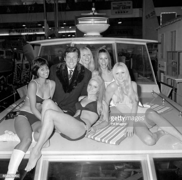 British actor Roger Moore met a bevy of beauty during the preview visit to the International Boat Show opening at Earls Court London The boat show...