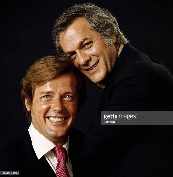 British actor Roger Moore photographed with Tony Curtis in the Lichfield Studio on 8th July 1971 They costarred in The Persuaders
