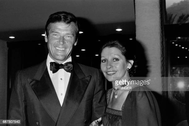 British actor Roger Moore poses with his wife Italian actress Luisa Mattioli on April 30 in Monaco British actor Roger Moore who will forever be...