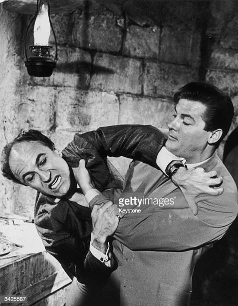 British actor Roger Moore struggles with Barry Morse in a scene from the TV series 'The Saint'