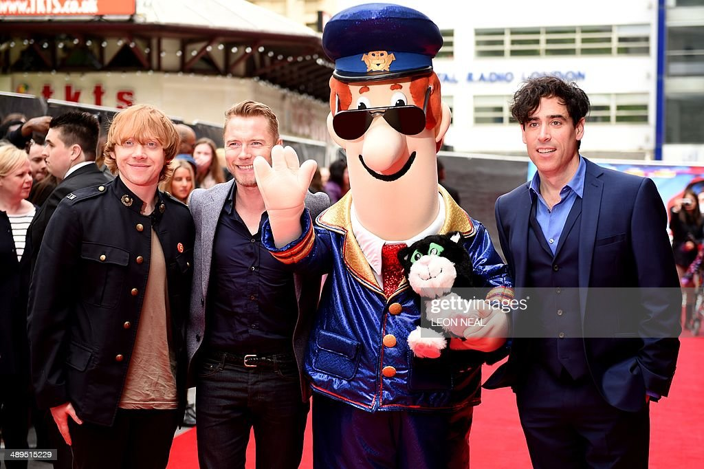 British actor Rupert Grint Irish singer Ronan Keeting and British actor Stephen Mangan pose for photographs with Postman Pat ahead of the world...