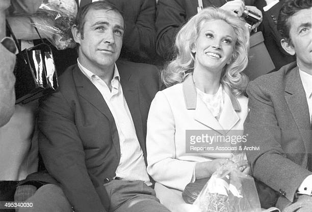 British actor Sean Connery sitting among other people with his wife Diane Cilento for a film festival Vienna 1968