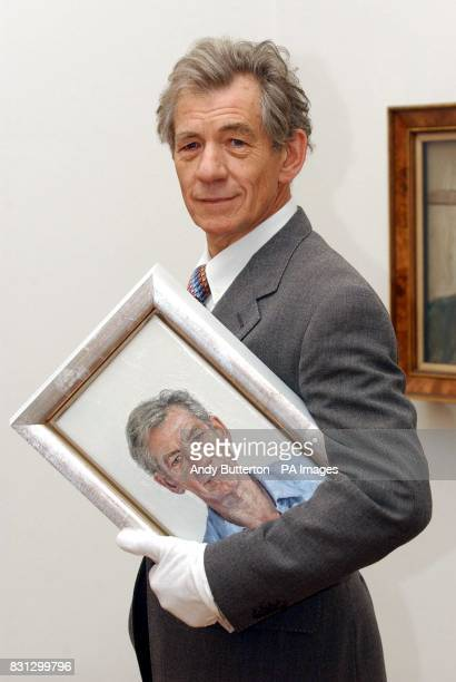 British actor Sir Ian McKellen with a new portrait of himself by Clive Smith during a photocall at the National Portrait Gallery in London The work...