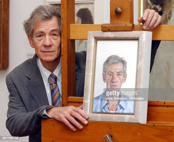British actor Sir Ian McKellen with a new portrait of himself by Clive Smith during a photocall at the National Portrait Gallery The work will go on...