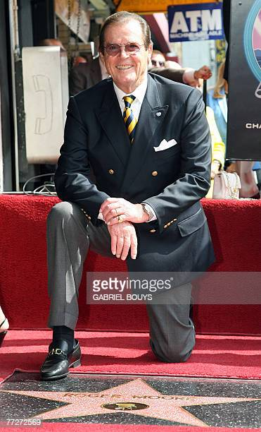 British actor Sir Roger Moore poses after being honored with a Star on the Hollywood Walk of Fame 11 October 2007 in Hollywood California Moore...