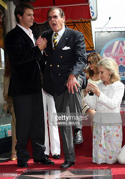 British actor Sir Roger Moore poses with his wife actress Christina Tholstrupafter and his son Geoffrey after being honored with a Star on the...