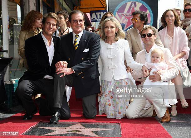 British actor Sir Roger Moore poses with his wife actress Christina Tholstrup and his family after being honored with a Star on the Hollywood Walk of...