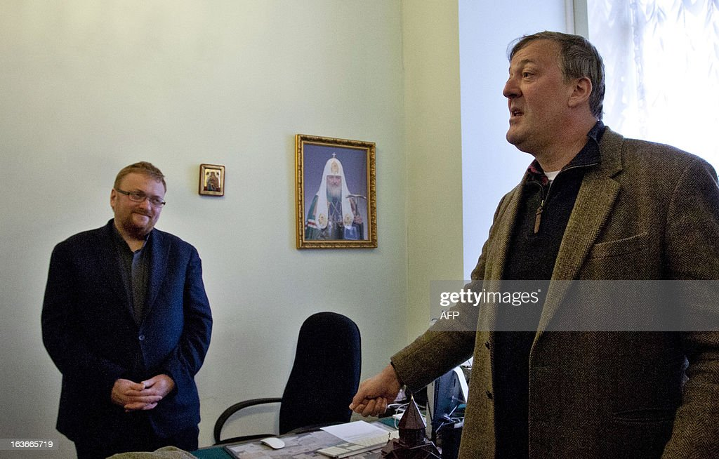 British actor Stephen Fry (R) speaks with Russian lawmaker Vitaly Milonov (L) as they meet at the city parliament in Saint Petersburg, on March 14, 2013. Fry, who is openly gay, clashed today with the Russian politician behind a controversial law in the city of Saint Petersburg that activists see as violating the rights of gays.