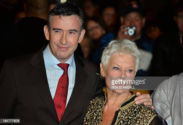 British actor Steve Coogan poses for photographs along with British actress Judi Dench as they arrive for the premiere of the film Philomena in...
