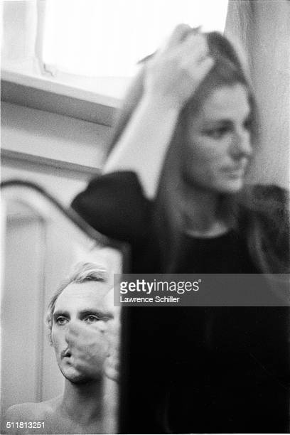 British actor Terence Stamp applies makeup in a mirror as an unidentified woman watches during production of 'Toby Dammit' one section of the...