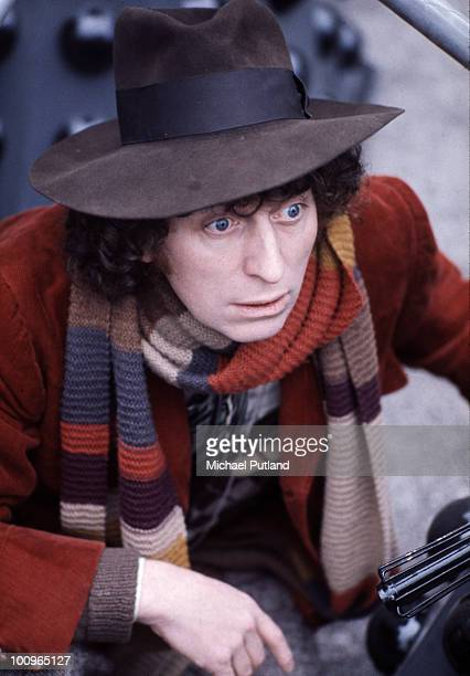 British actor Tom Baker in his bestknown role as Dr Who between two of his arch enemies the Daleks at BBC TV Centre London 1974
