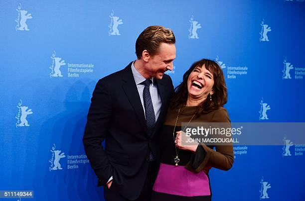 British actor Tom Hiddleston and Danish director Susanne Bier pose for photographers as they arrive for a sreeening of Berlinale Special Series ' The...