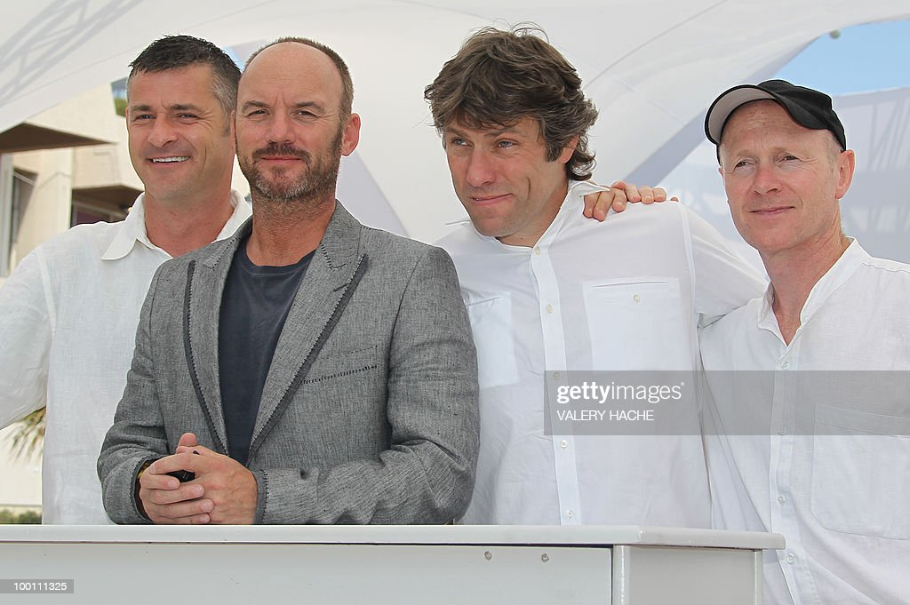 British actor Trevor Williams, British actor Mark Womack, actor John Bishop and screenwriter Paul Laverty pose during the photocall 'Route Irish' presented in competition at the 63rd Cannes Film Festival on May 21, 2010 in Cannes.