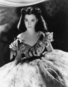 British actor Vivien Leigh wears a period costume in a promotional portrait for director Victor Fleming's film 'Gone With The Wind'
