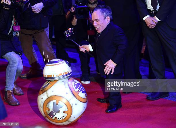 British actor Warwick Davies poses for a selfie with Star Wars droid BB8 during the opening of the European Premiere of 'Star Wars The Force Awakens'...