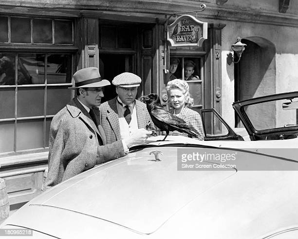 British actors Basil Rathbone as Sherlock Holmes and Nigel Bruce as Doctor Watson with American actress Hillary Brooke as Sally Musgrave in 'Sherlock...