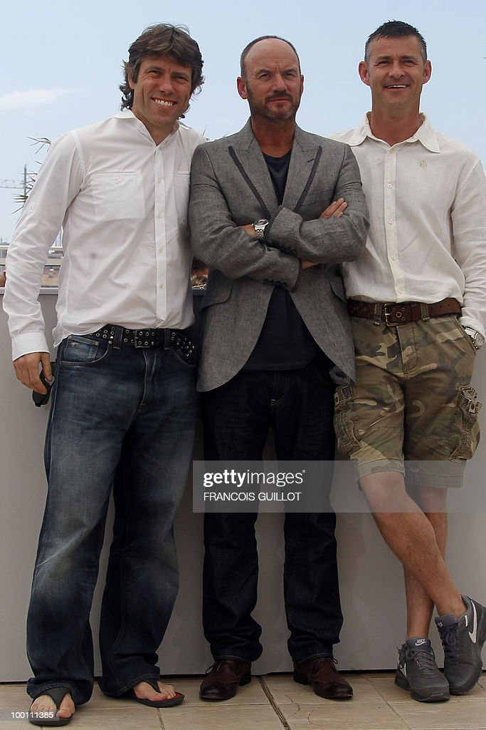 British actors <a gi-track='captionPersonalityLinkClicked' href=/galleries/search?phrase=John+Bishop+-+Actor&family=editorial&specificpeople=7360807 ng-click='$event.stopPropagation()'>John Bishop</a>, Mark Womack and Trevor Williams pose during the photocall 'Route Irish' presented in competition at the 63rd Cannes Film Festival on May 21, 2010 in Cannes.