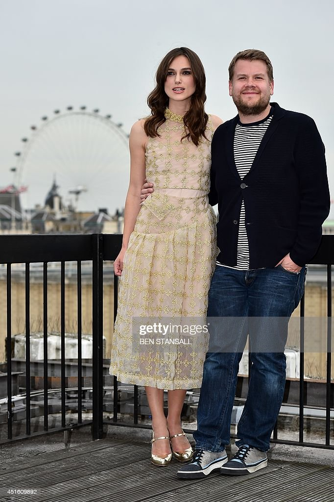 British actors Keira Knightley (L) and James Corden (R) pose for a photograph at a photocall for their film 'Begin Again' in central London on July 2, 2014.