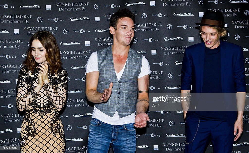 British actors Lily Collins (L), Kevin Zegers (C) and Jamie Campbell arrive for the Norway premiere of the movie 'The Mortal Instruments: City of Bones' in Fredrikstad, Norway on August 23, 2013, prior to the Norway premiere of the movie 'The Mortal Instruments- City of Bones'. AFP PHOTO / GROTT, VEGARD/NTB scanpix NORWAY OUT