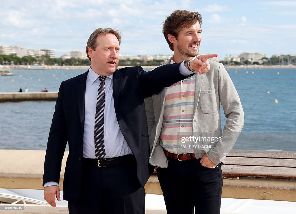 British actors Neil Dudgeon (L) and Gwilym Lee pose during a photocall for the TV series 'Midsomer murders' as part of the Mipcom international audiovisual trade show at the Palais des Festivals, in Cannes, southeastern France, on October 7, 2013. AFP PHOTO / VALERY HACHE