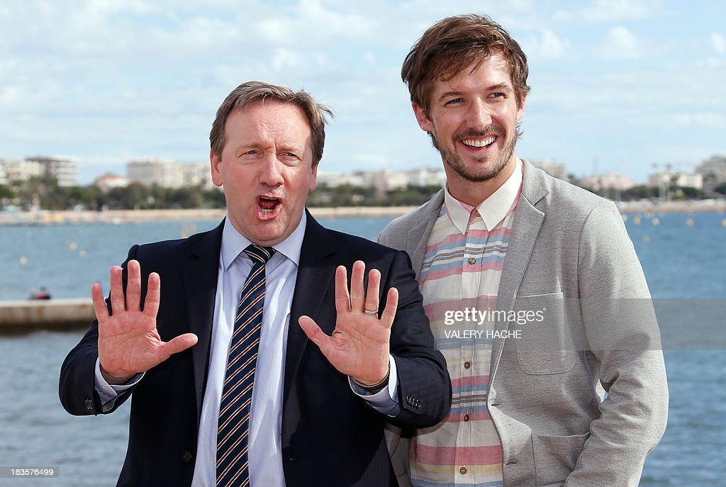 British actors Neil Dudgeon (L) and Gwilym Lee pose during a photocall for the TV series 'Midsomer murders' as part of the Mipcom international audiovisual trade show at the Palais des Festivals, in Cannes, southeastern France, on October 7, 2013.