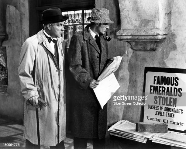 British actors Nigel Bruce as Dr Watson and Basil Rathbone as Sherlock Holmes in 'Pursuit to Algiers' directed by Roy William Neill 1945