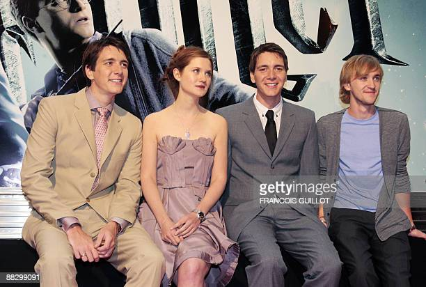 British actors Oliver Phelps Bonnie Wright James Phelps and Tom Felton pose during a photocall on June 8 2009 in Gare du Nord train station in Paris...