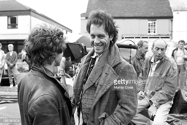 British actors Paul McGann and Richard E Grant film a scene in Stony Stratford Buckinghamshire for the movie 'Withnail I' 1986